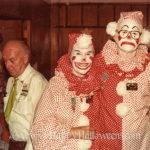 Creepy clown couple from somewhere in the 1970s