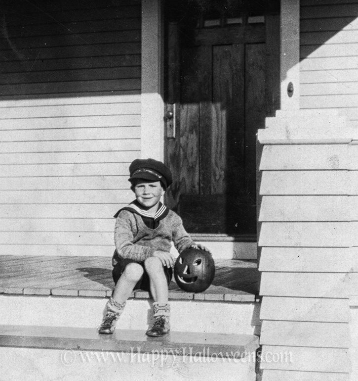 Proud boy and his pumpkin, 1940s