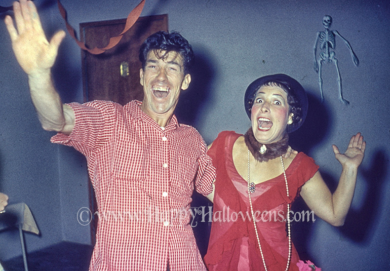 Happy party couple, love the skeleton decoration - 1950s