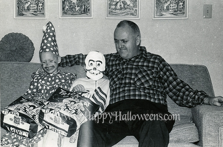 Dad and kids and Trick or Treat bags - 1960s / 70s