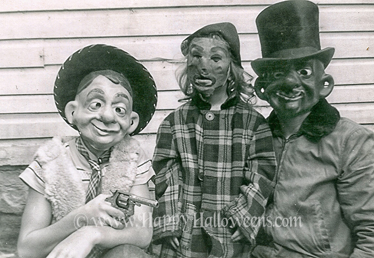 A trio of grotesque kid's masks from the 1950s